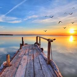 Zachód słońca nad jeziorem - obrazy drukowane na płótnie